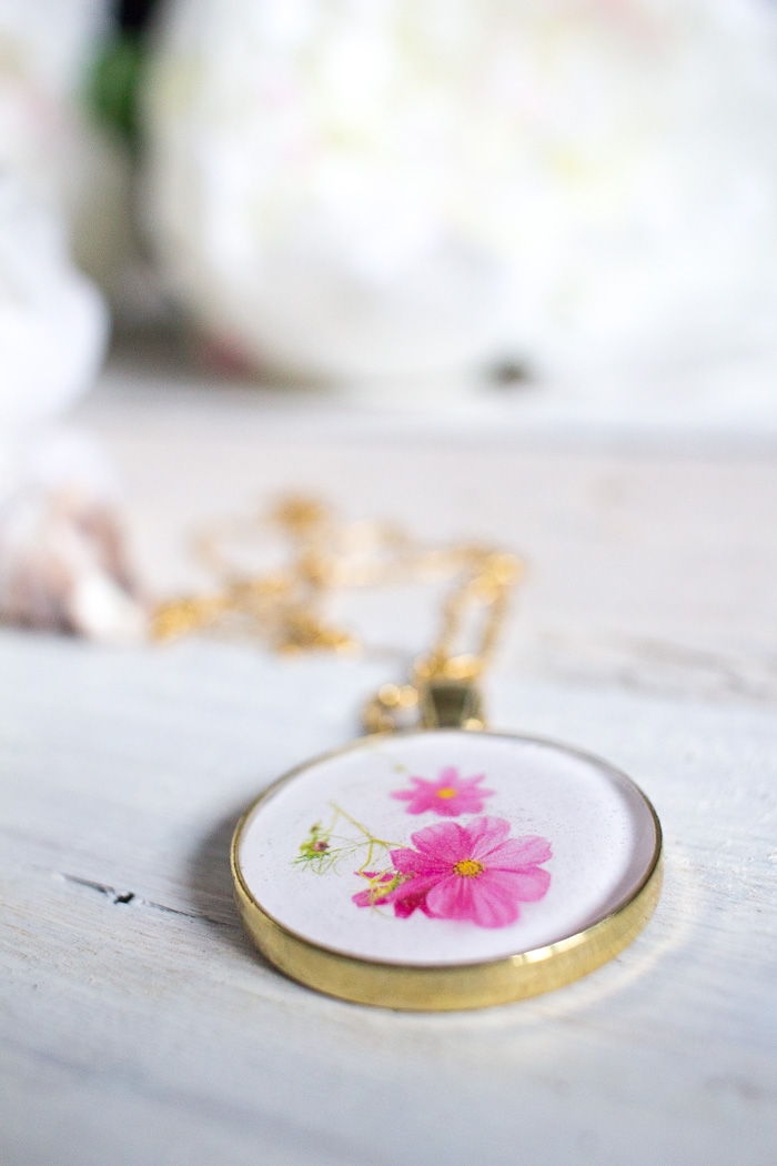 Thoughtful DIY resin jewelry idea. Learn how to make this birth month flower pendant with floral photos and resin. A beautiful birthday, Mother's Day or Christmas gift idea for her.