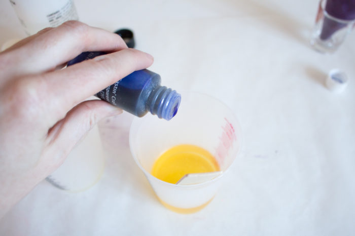 Adding Universal Transparent Dye to Fast Cast Resin to create a marbled effect.