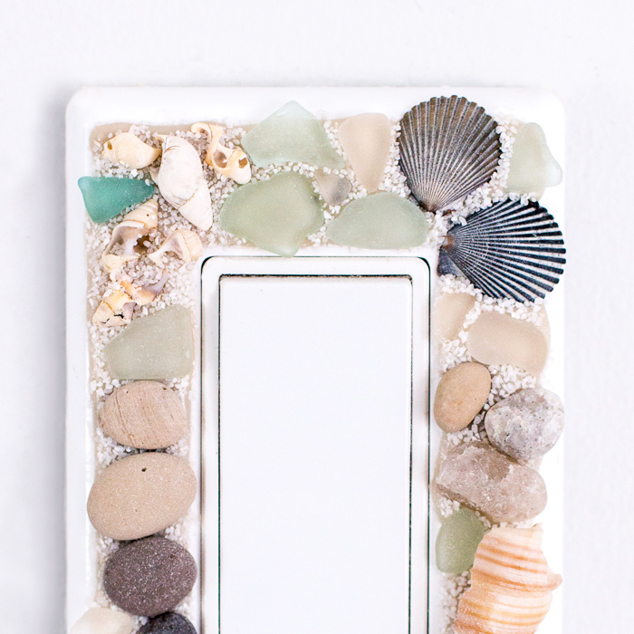 DIY beach-themed decorative switch plate covers with sea glass, stones and shells. An easy way to embellish those light switch covers for a coastal vibe!