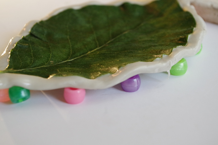 DIY Leaf Imprint Clay Bowls- place beads underneath wax paper and clay to lift sides