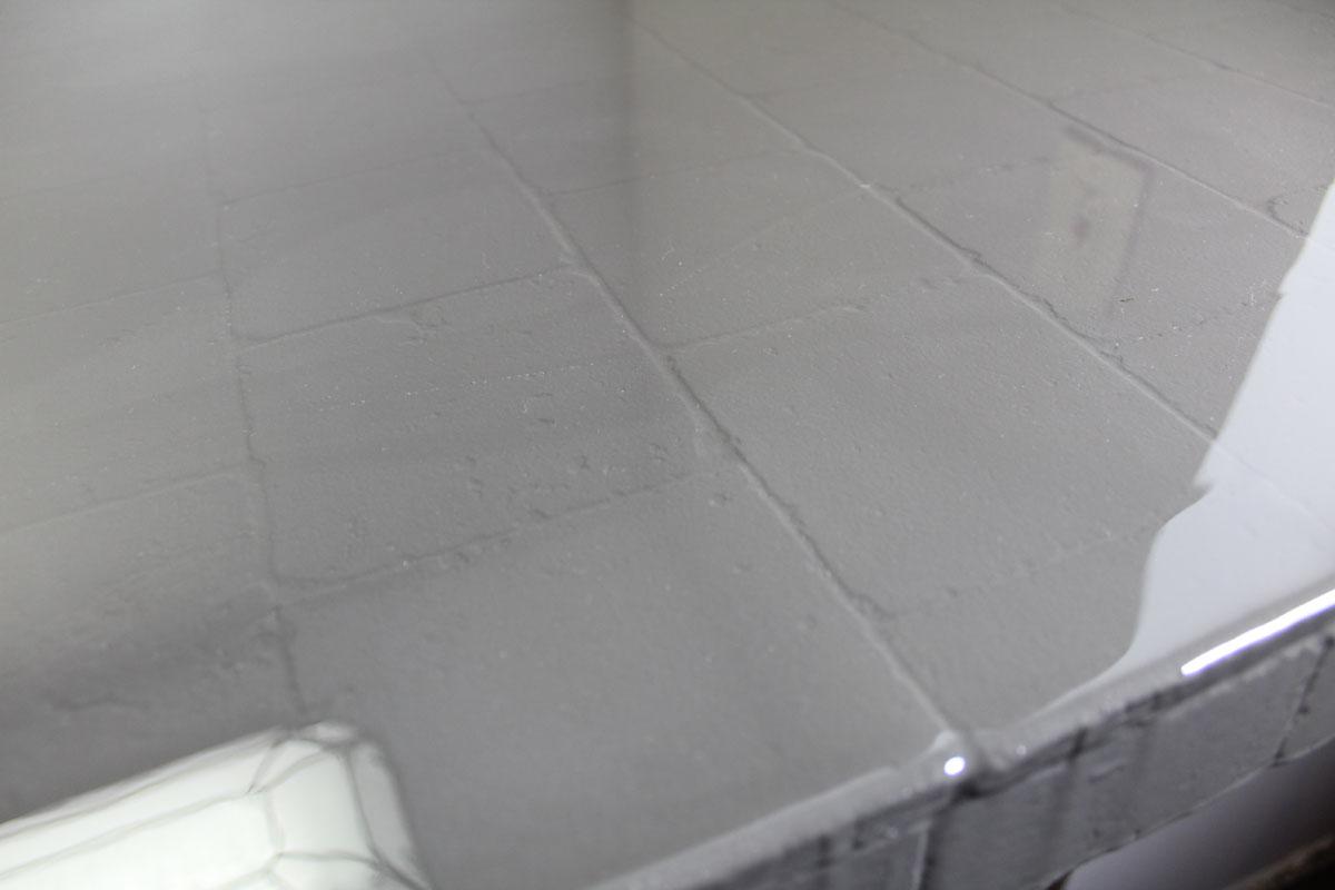 high gloss bar counter makeover | whitney j decor | interior design | decorating diy projects | charcoal gray bar | envirotex lite bar | bartop | bar makeover | home bar makeover | large bar | diy resin makeover | diy bar decor | diy resin decor
