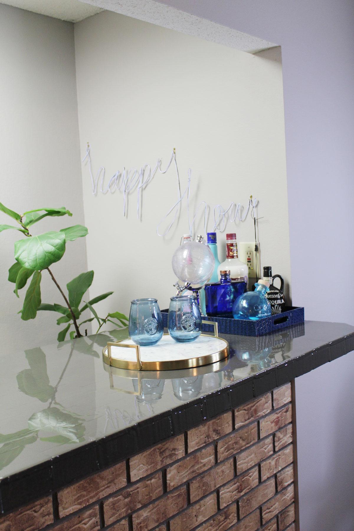 high gloss bar top makeover | whitney j decor | interior design | decorating diy projects | charcoal gray bar | envirotex lite bar | bartop | bar makeover | home bar makeover | large bar | diy resin makeover | diy bar decor | diy resin decor