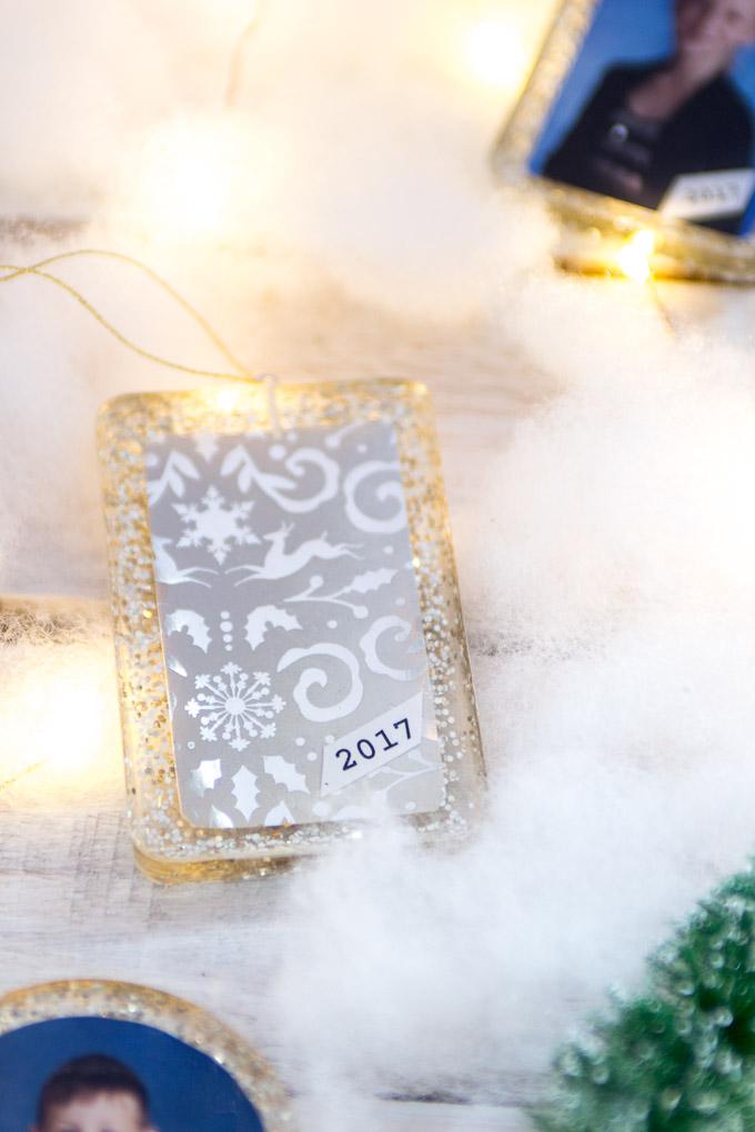 Gorgeous DIY resin photo ornaments! Tutorial for Christmas ornaments with school photos. Gift idea for grandparents. #Christmasornaments #diyornaments #keepsake #giftforgrandma