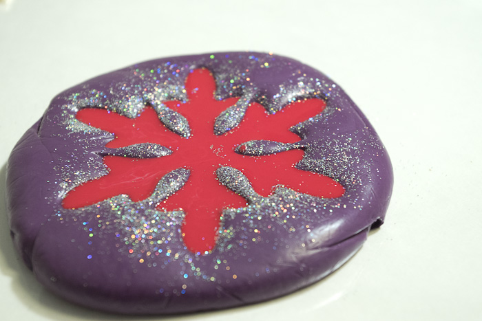 Snowflake mold and castings- pour in more fastcast that had red pigment added to it