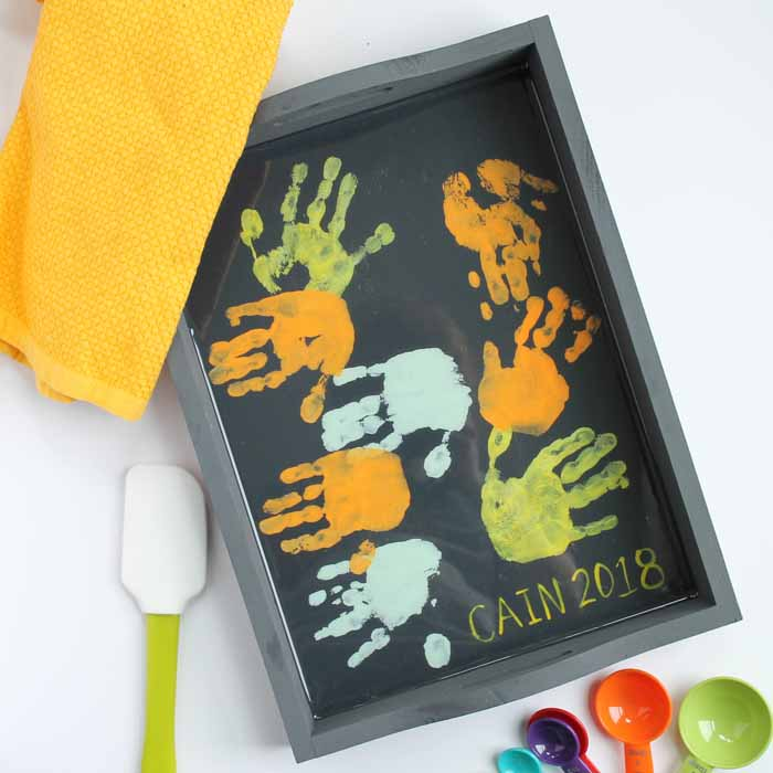 Make this hand print tray for Mother's Day! Easy to make and mom will love it!