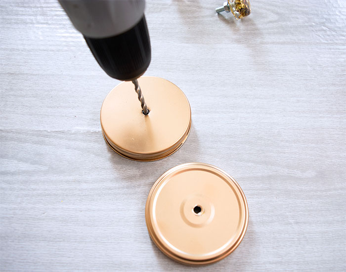 Drill holes in your jar lids