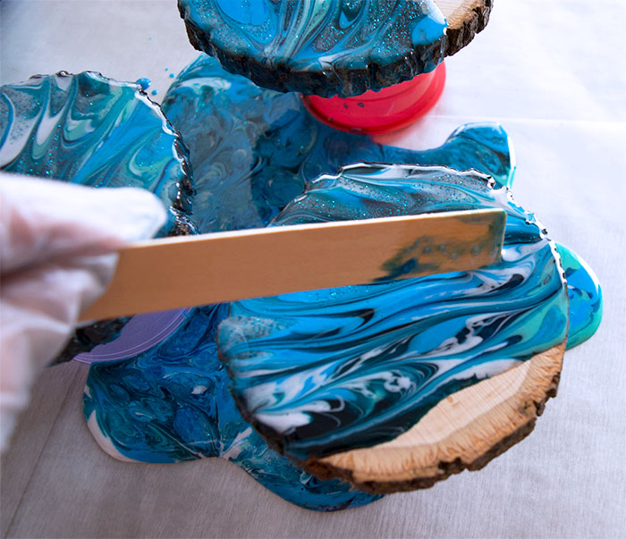 Use a stir stick to help the marbling