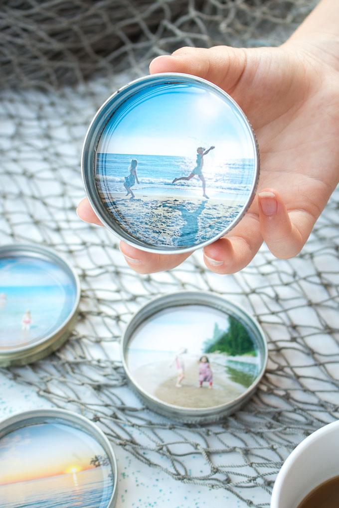 Such a sweet idea! DIY photo coasters with resin and mason jar lids as a summer keepsake. #resincrafts #keepsake #giftidea #masonjarcrafts
