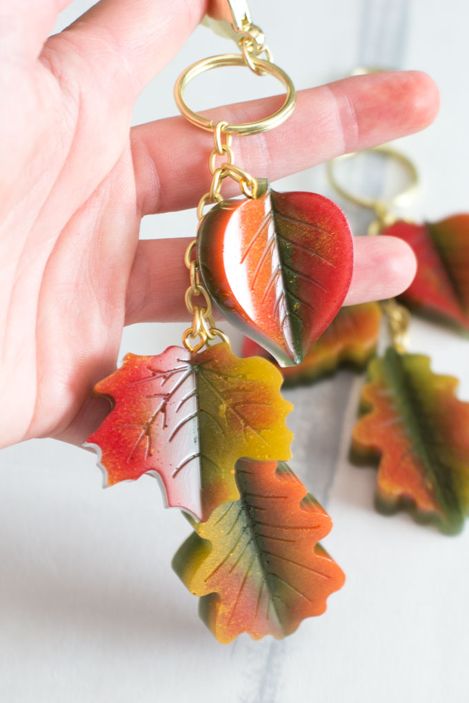 Red, yellow and orange resin leaves strung together on a gold chain and key ring