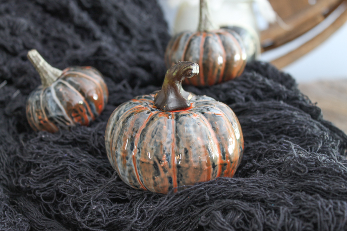 These marbled resin pumpkins are easy to make and perfect for your Halloween and fall decor!