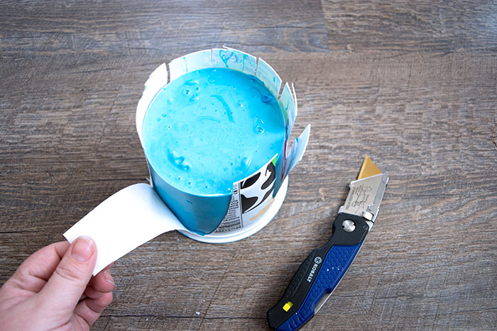 Cut away the container from the mold
