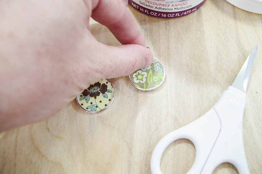 DIY paper and resin pendants - glue paper into bezels