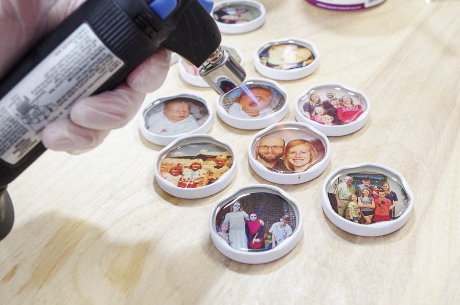 DIY Photo Magnets using resin in milk bottle lids - pop bubbles with micro butane torch