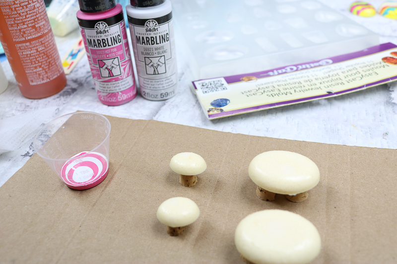Setting up pieces for a paint pour.