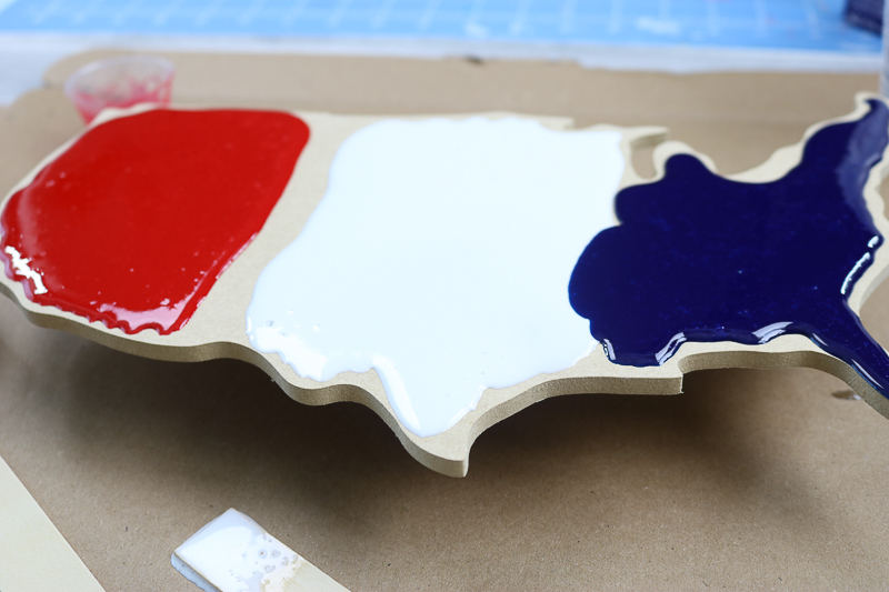 pouring resin onto a united states cutout