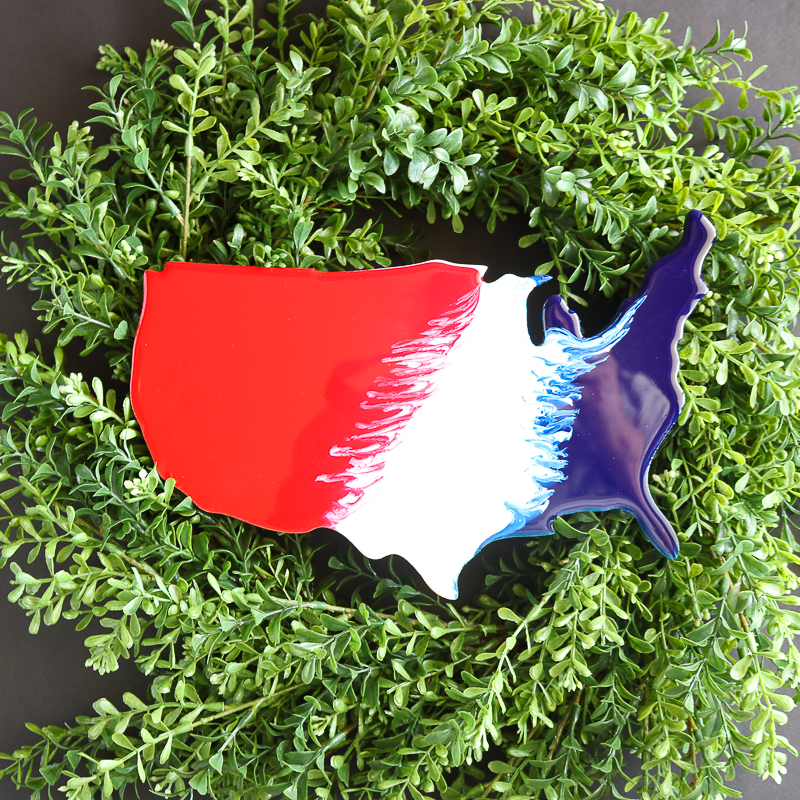 Patriotic farmhouse wreath perfect for a front door in summer