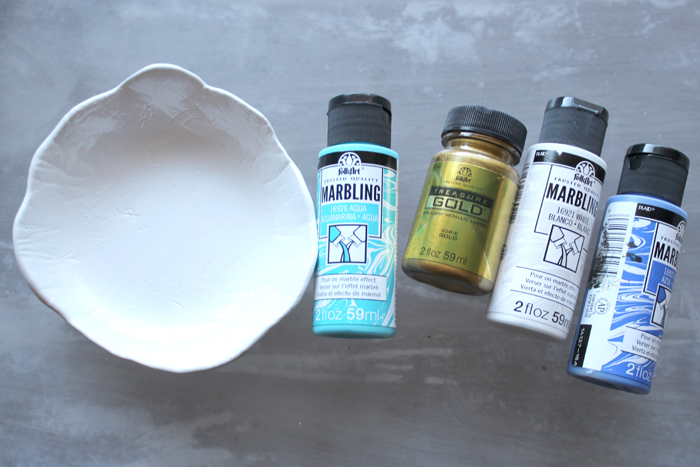 How to make a marbled ring dish with Easy Sculpt resin trimmed in gold for a gift or the perfect ring storage solution.