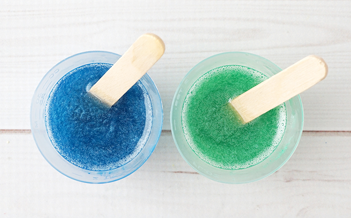 Blue and green resin in mixing cups