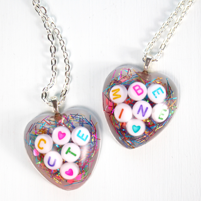 Make a conversation heart resin Valentine necklace with resin for the perfect Valentine's day gift for a friend.