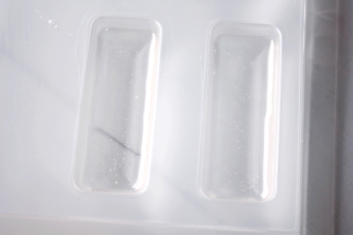 Pour resin into molds