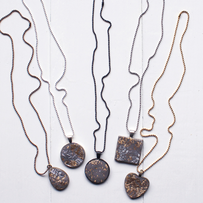 Let the jewelry clay dry and then string the bezels on chains for the perfect necklaces.