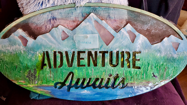 Resin Adventure Awaits sign