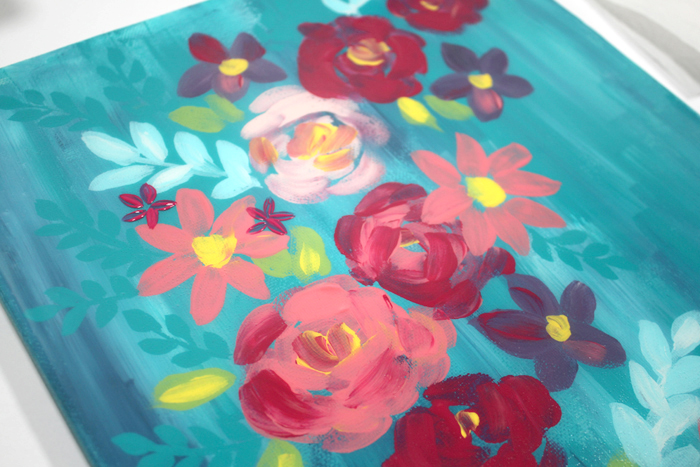 Step 4: Next Layer of Flowers Now add another layer of flowers, leaves, fronds, spots, dots and lines over the resin.