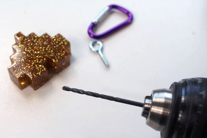 Use a drill bit the size of the screw eye to pilot a small hole in the top of the heart.