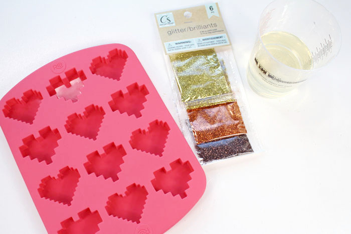 Supplies Needed for Pixel Heart Keychains: EasyCast Resin Glitter Pixel Heart Silicone Mold Mixing Cups, Stirring Sticks, Disposable Gloves Screw Eyes Drill/Bit Mini Carabiner