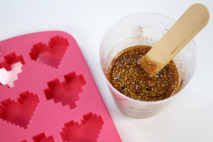 Step 2: Pouring Resin in Pixel Heart Mold Now pour the glittery mixed resin into the pixel heart silicone mold.
