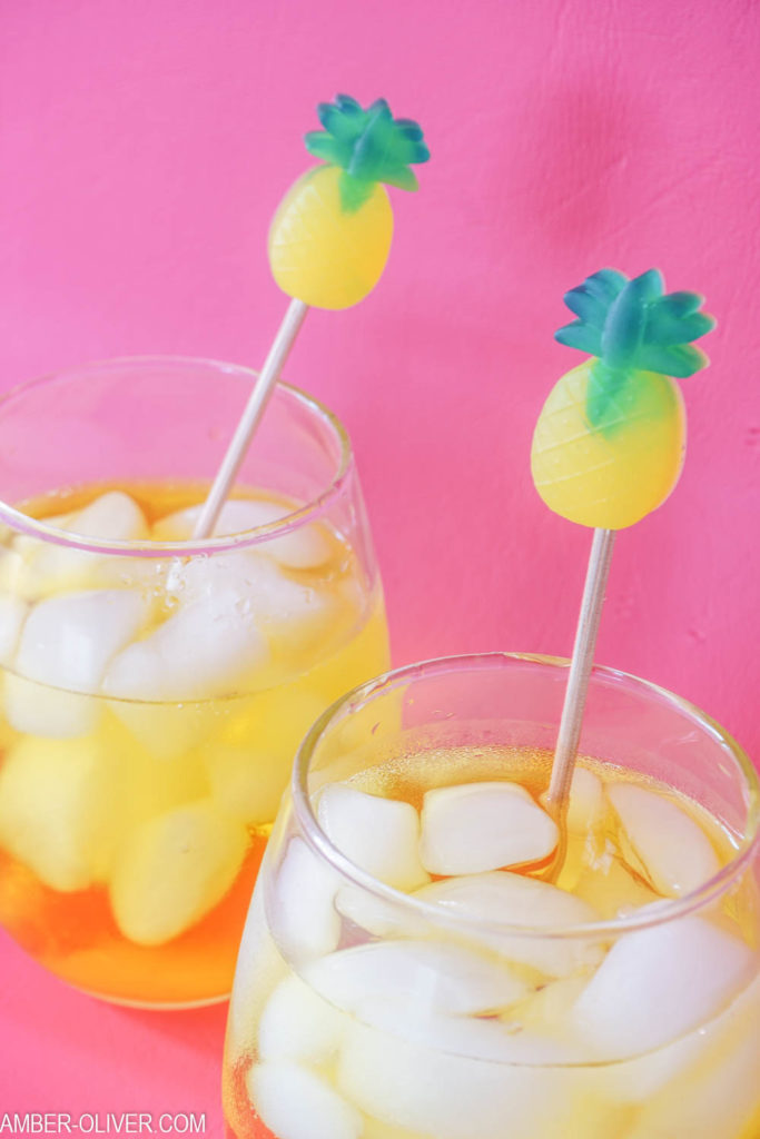 pineapple drink stirrers in glasses