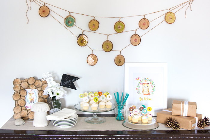 So cute! This wood slice garland makes adorable woodland themed baby shower, birthday or nursery decor. Tutorial to make it with a resin top coat is included.