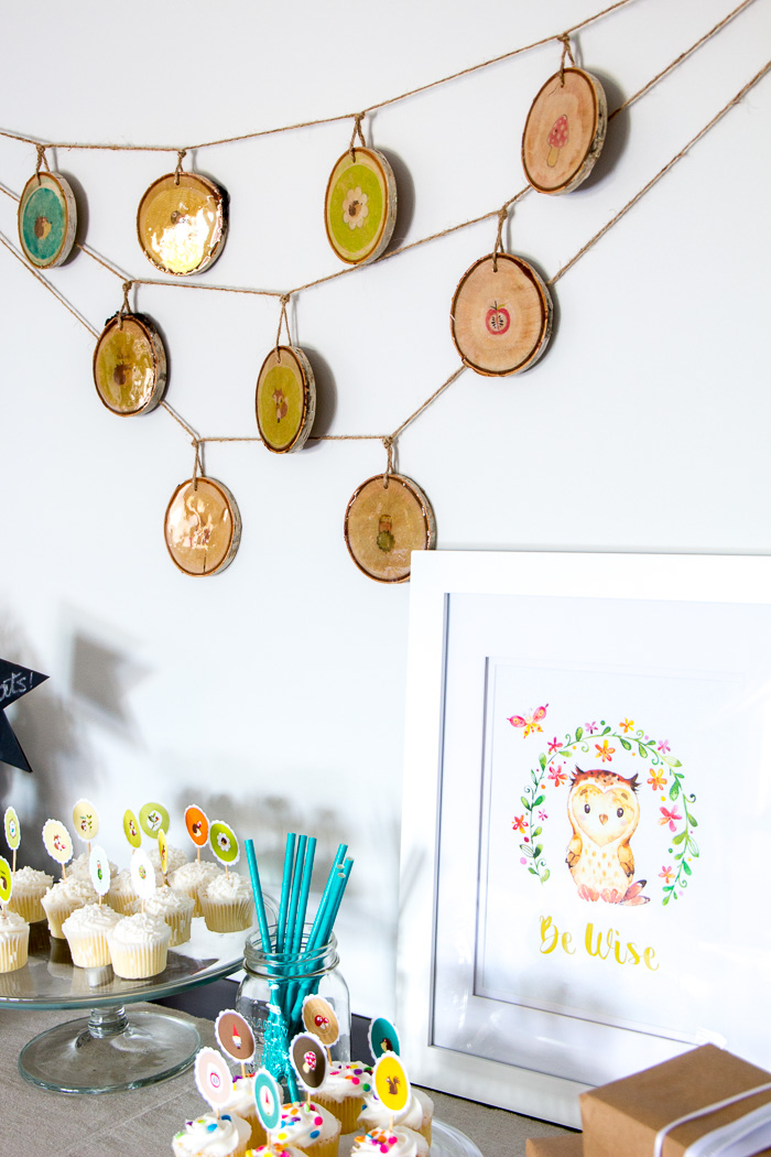 Woodland nursery decor ideas and woodland baby shower decorations. A step-by-step tutorial is included to make the rustic wood slice garland!