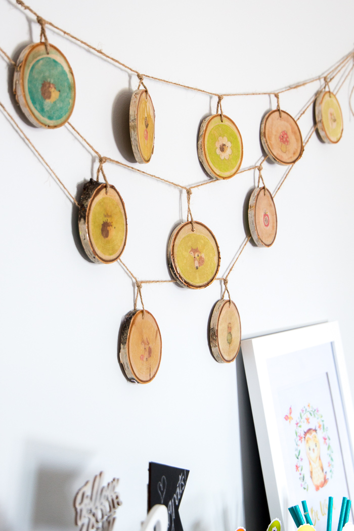 Lovely woodland nursery decor idea! Wood slices with woodland creature images and coated with resin. Step-by-step tutorial is included!