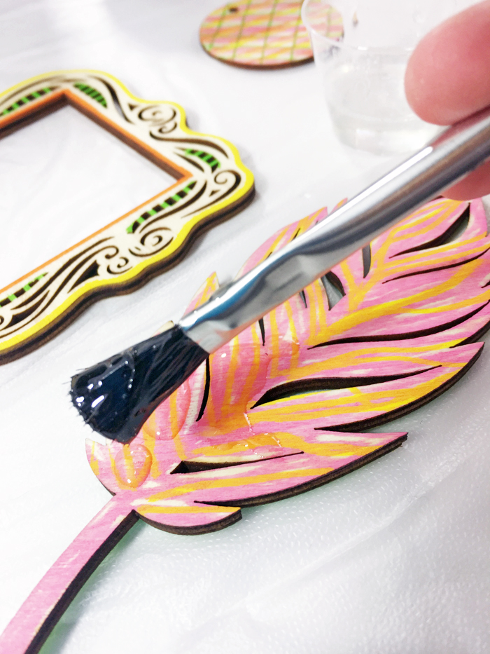 Shiny Wood Cutouts - Adding resin to feather
