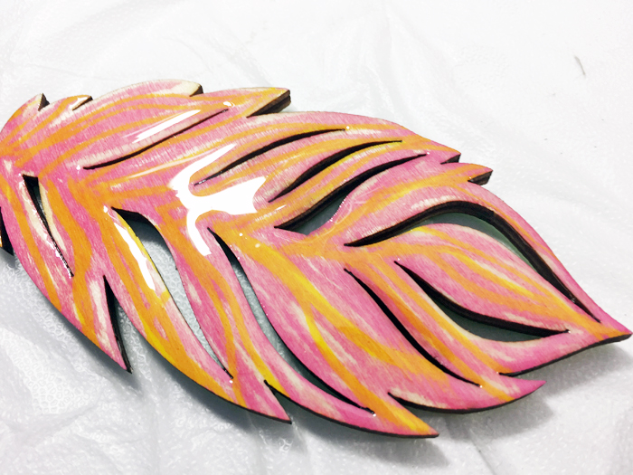 Shiny Wood Cutouts - Feather covered in resin