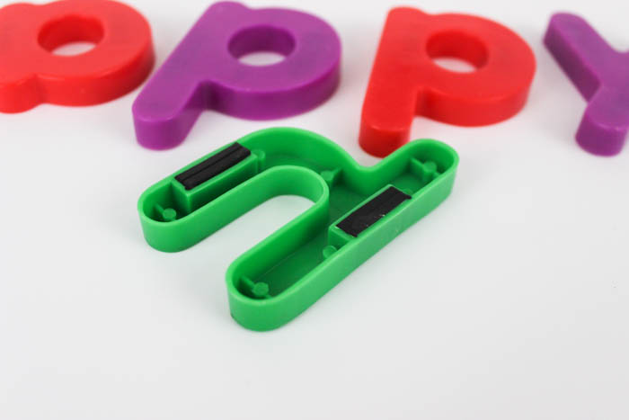 Easy and creative DIY chocolate letters! Make your own molds from fridge magnets, and form chocolate letters in just a few minutes! Perfect for spelling out names, dates, etc for birthdays, weddings, anniversary parties, engagement parties, and more!