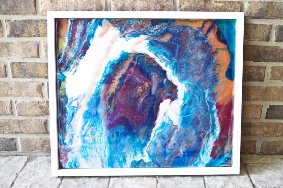 Poured Resin Wall Art - Completed art against brick backdrop