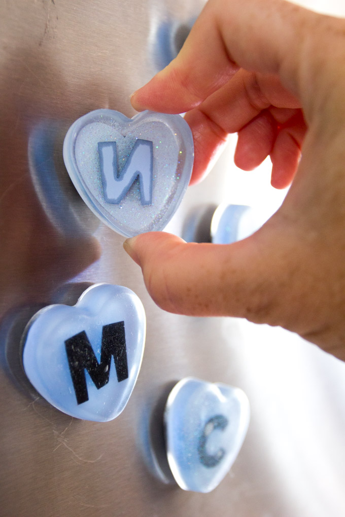 DIY fridge magnets! Monogram heart magnets made with resin. Back-to-school craft idea or loot bag gift idea.