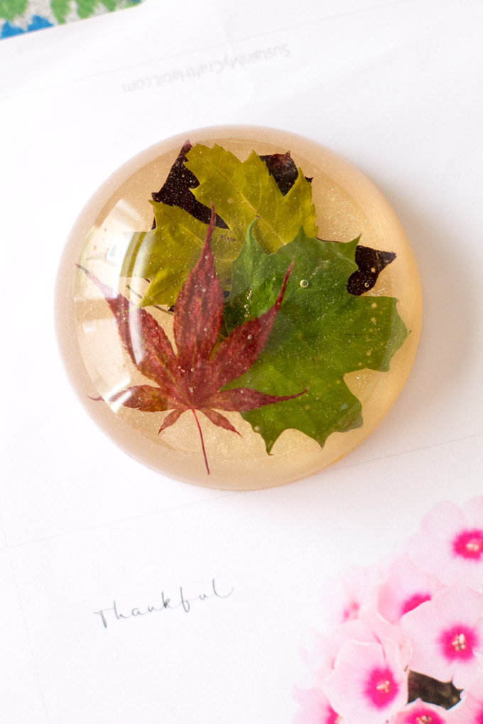 Paperweight made with leaves cast in resin. Collect various colours and types of leaves for this DIY office craft idea.