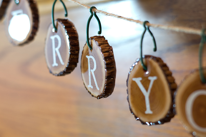 Resin Coated Merry Christmas Wood Slice Garland - resin coated wood slices finished, hang on string to make garland - closeup