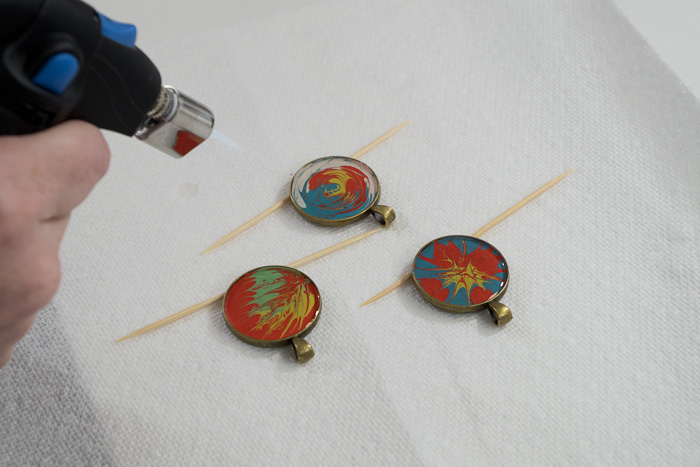 Paint and Resin Necklaces - use micro butane torch to pop bubbles