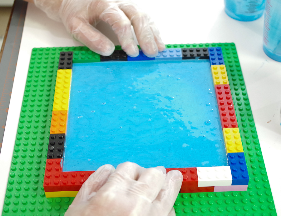DIY Lego Mold using silicone rubber - After filled, make sure to press down on the legos to ensure the form is solid