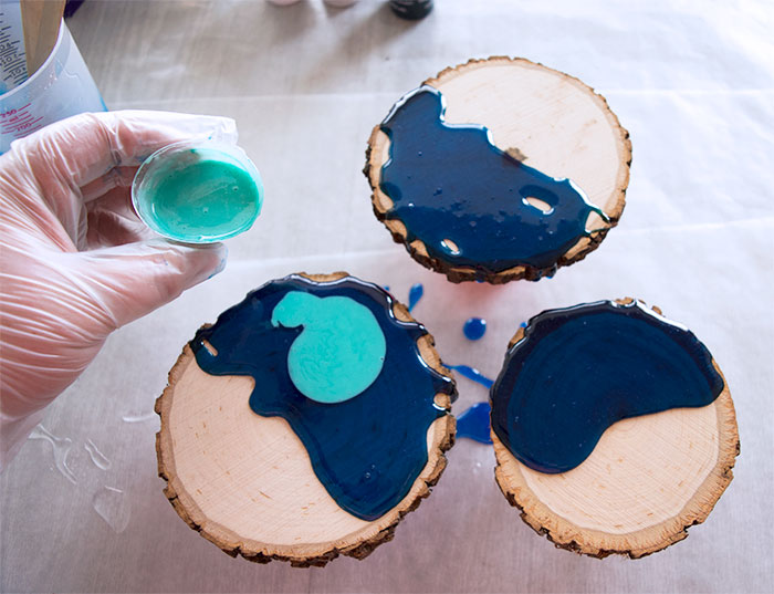 Pouring resin onto wood coasters