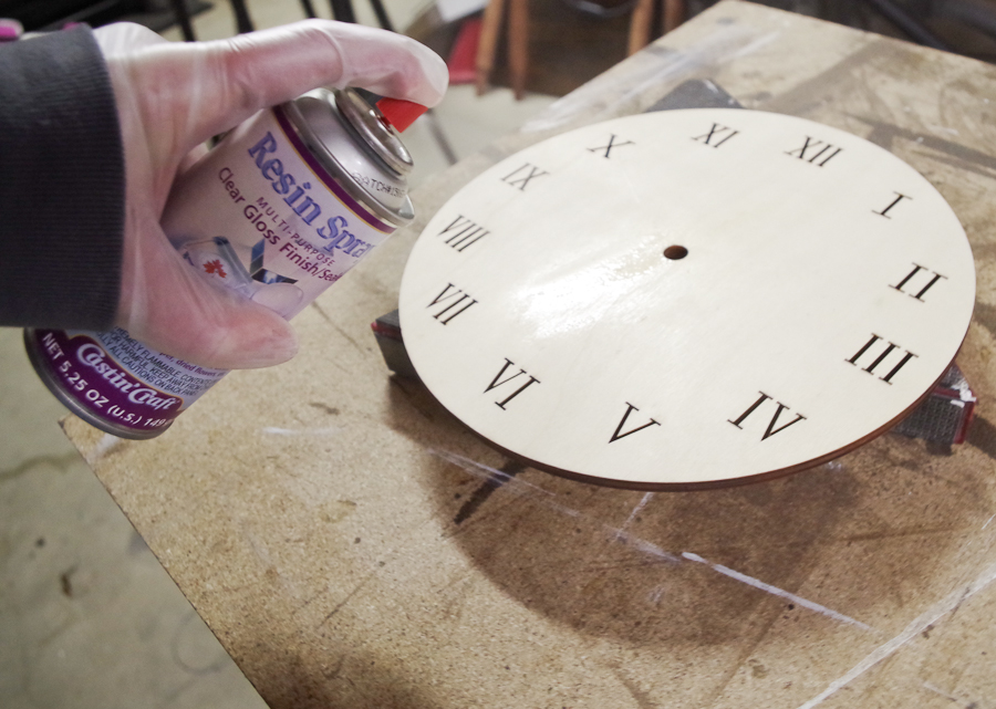 Wood and Resin Clock - spray with resin spray to coat the wooden clock face