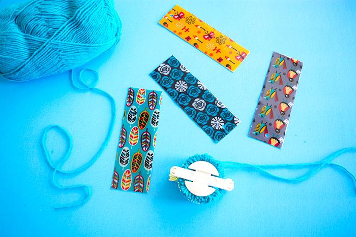 Add a yarn pom pom to the bookmark