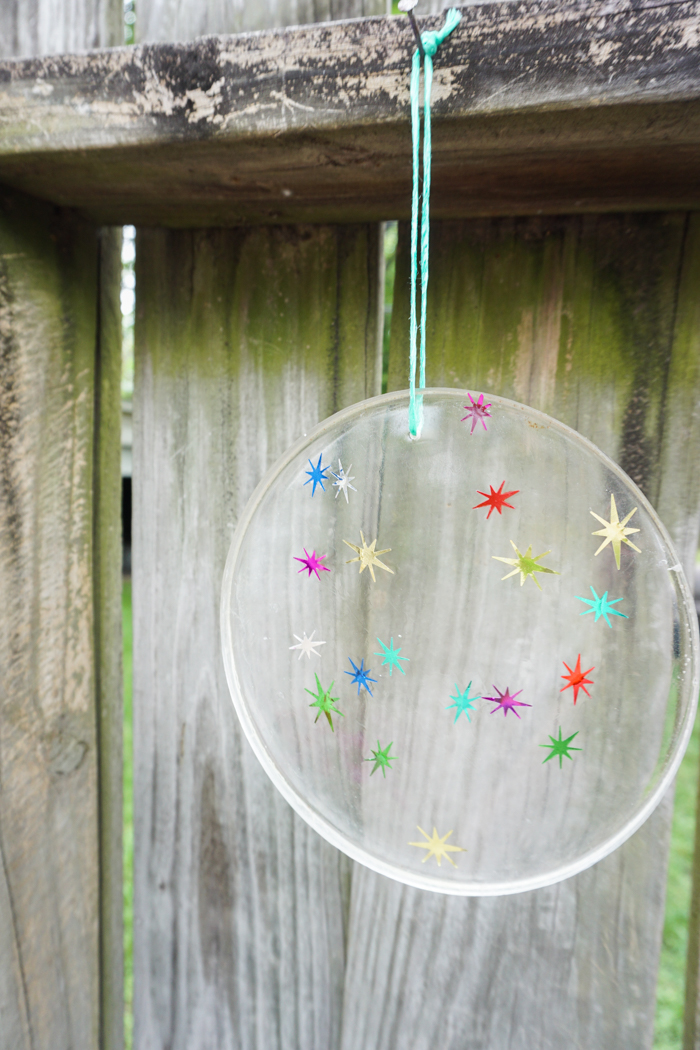 a resin suncatcher hanging in the garden