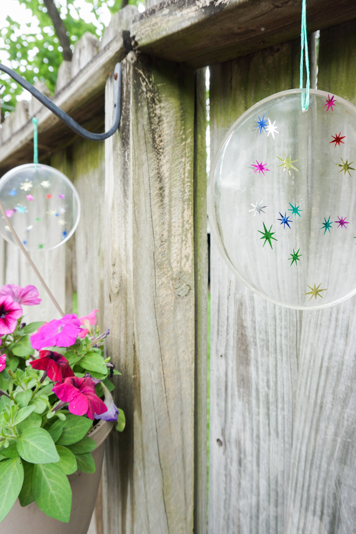 resin suncatchers hanging in the garden