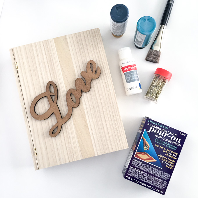 Supplies needed to make a decorative keepsake wooden box with a love sign on the front