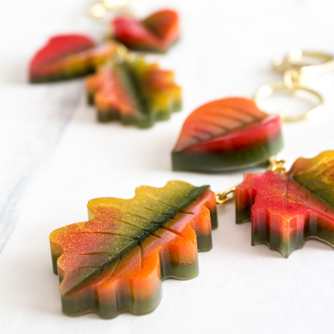 Close up image of fall-coloured resin leaves strung togetehr on a keychain